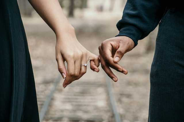man and woman holding hands