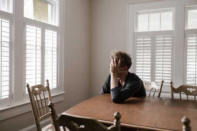 man thinking in his house