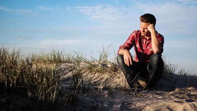 man thinking on the beach about estate planning