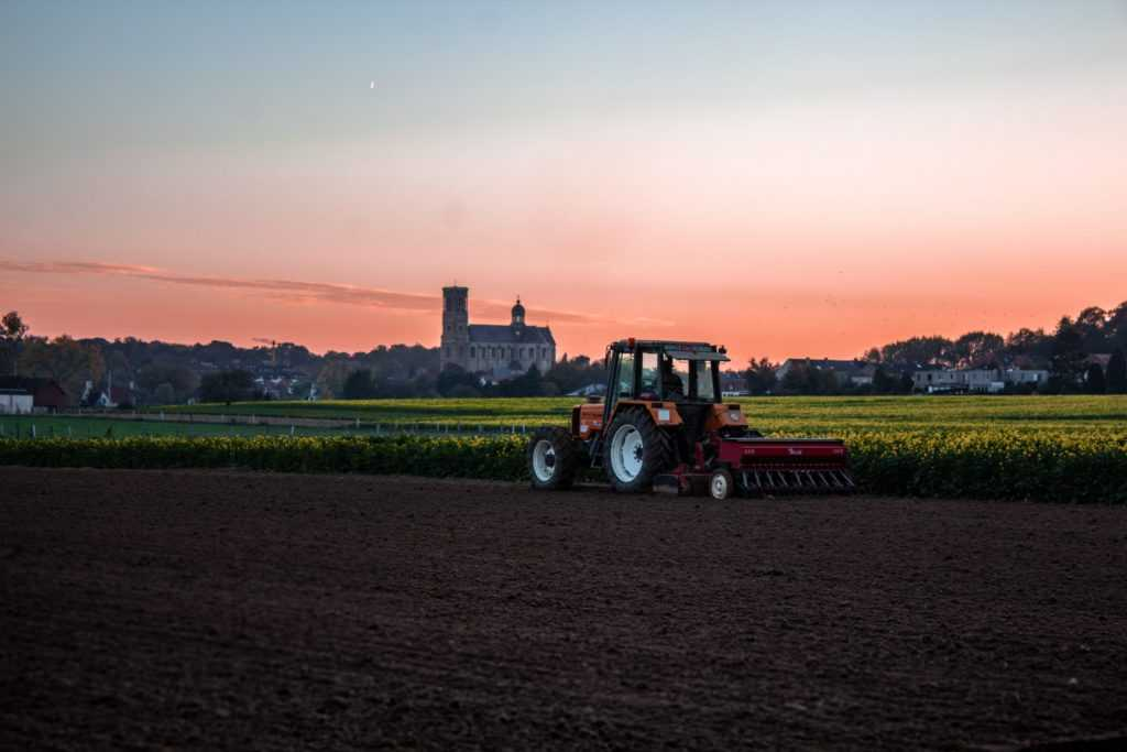 tractor on farm at sunset